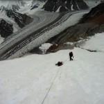 Mojtaba Jarahi helps in the rescue of Brian Moran on Broad Peak (Photo: John Quillen)
