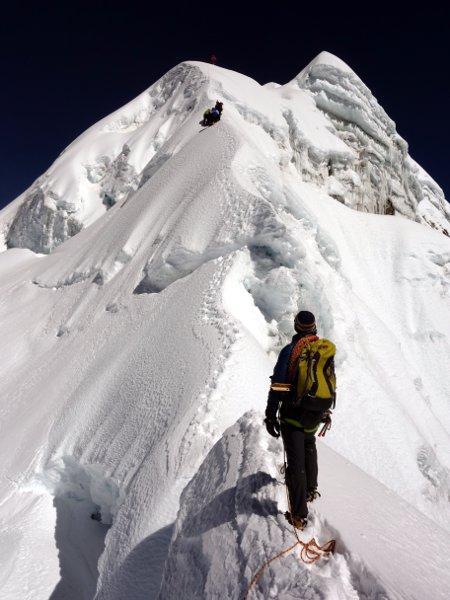 Samuli waits beneath Cholatse's final summit slope