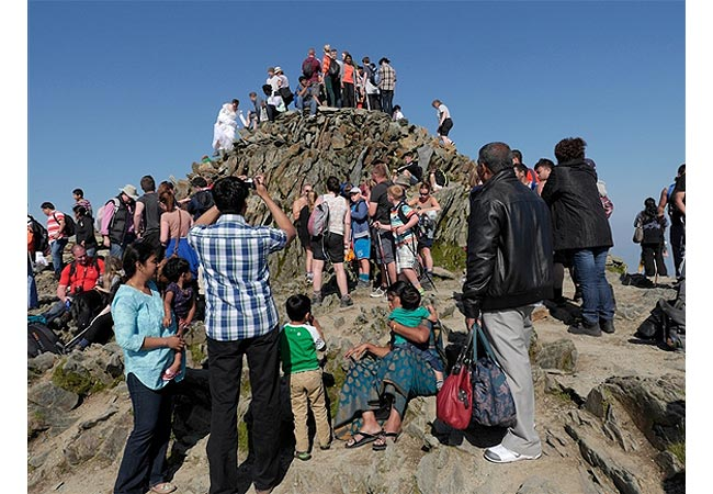 Queues on the summit of Snowdon on a busy August bank holiday weekend (Photo: Ray Wood)