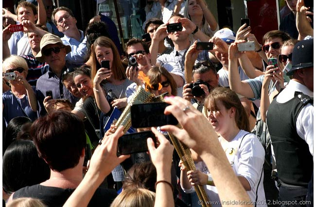 Londoners squeeze together to get a snapshot of the Olympic torch (Photo: Andy Wilkes)