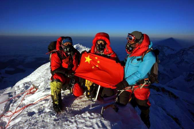 Chinese mountaineer Wang Jing with two of her Sherpa team on the summit of Everest after their helicopter assisted ascent this year (Photo: Wang Jing)
