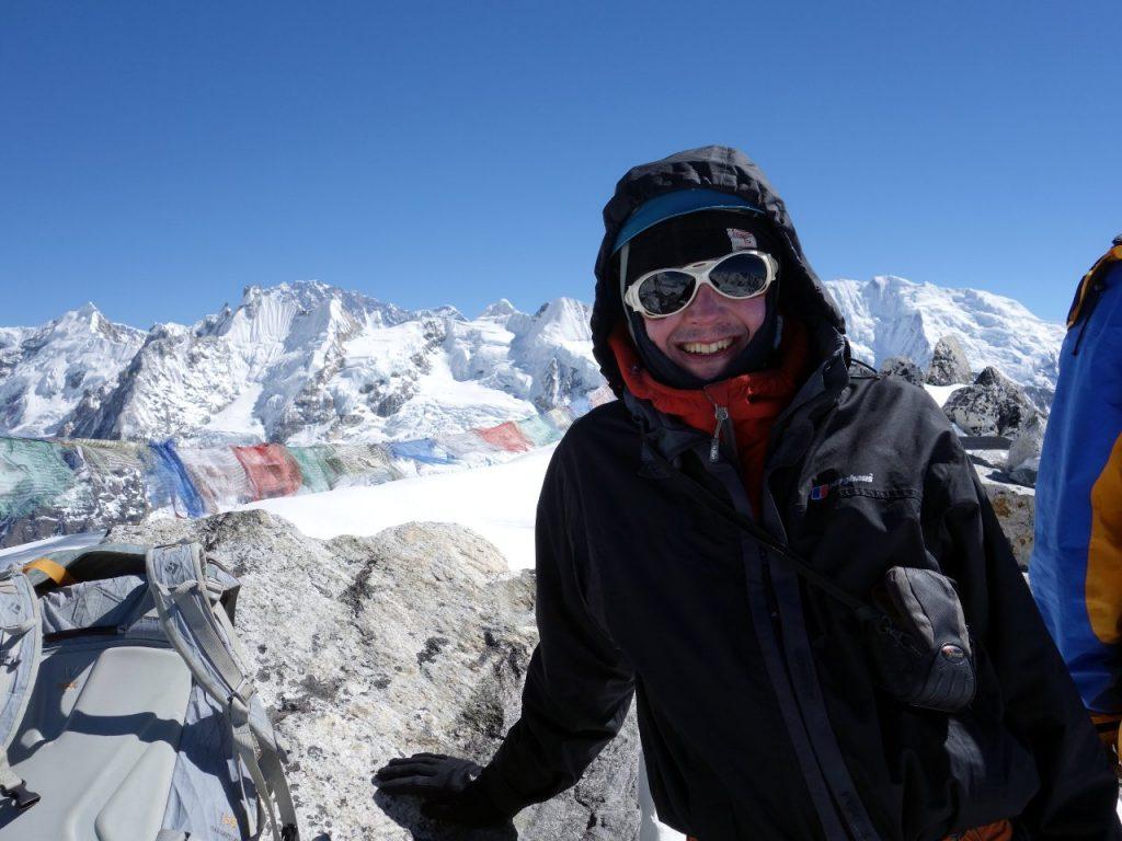 Me on the summit of Yala Peak (5530m), with Shishapangma (8013m) on the far horizon behind